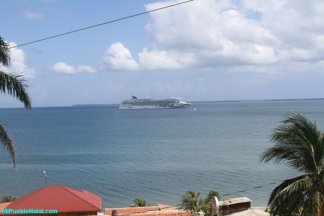 Cruise ship in the distance.