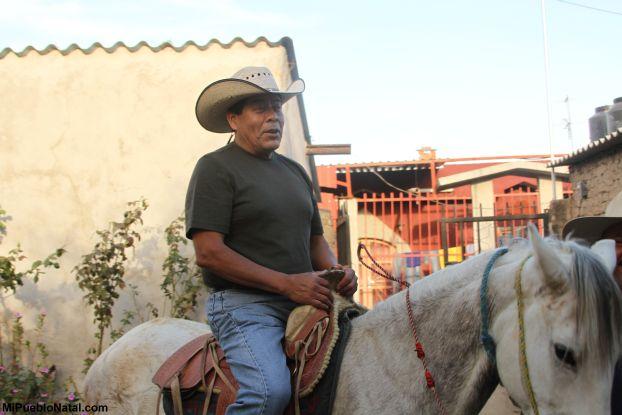Sentado en un caballo